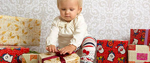Baby playing with Christmas gifts