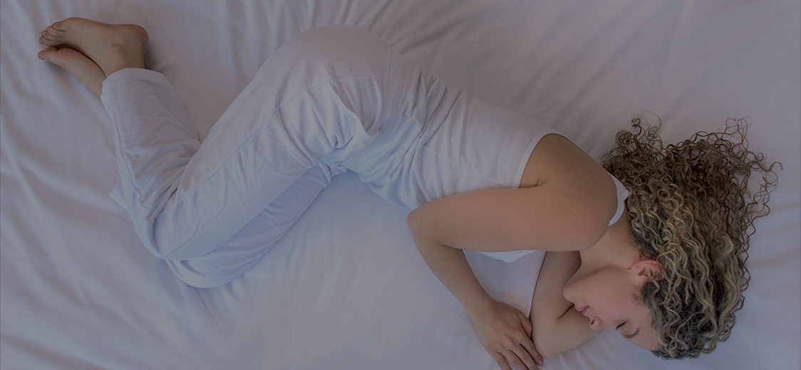 Young woman sleeping on a mattress